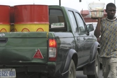 Shell oil barrels: The new oil and gas bill, which is set to be signed into law, will regulate the activities of multinational oil companies by ensuring locals are engaged in key economic sectors.