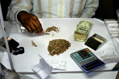 A wealthy dealer examines rough diamonds in his shop (file photo).