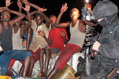 A group of Somali pirates (file photo): Security officials speculate the kidnappers may be pirates with financial ties to Al Shabaab.