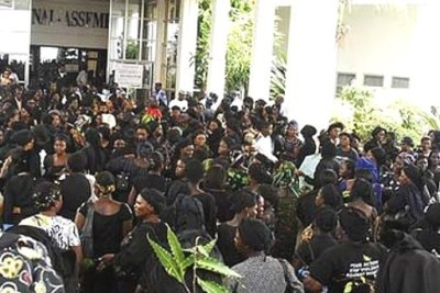 Women wearing black robes protest the killing of innocent women and children in Jos at the National Assembly, Abuja.