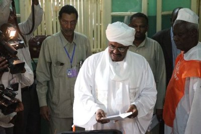 Sudanese President Omar Al Bashir voting (file photo).