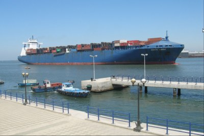 A cargo ship passes through the Suez Canal, a vital link in world trade, and contributes significantly to the Egyptian economy.