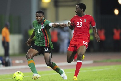 Jose Bokung Alogo of Equatorial Guinea challenges Zambia's Christopher Katongo, 11, during the final stages of the 2012 Afcon held in Equatorial Guinea.