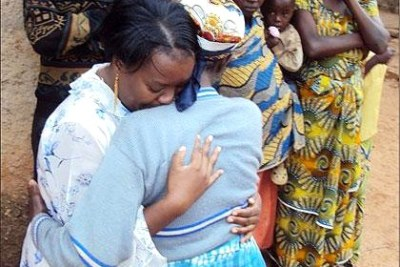 Left, Geraldine Mukakabego reunites with mother after 18 years of living in Zambia (file photo).
