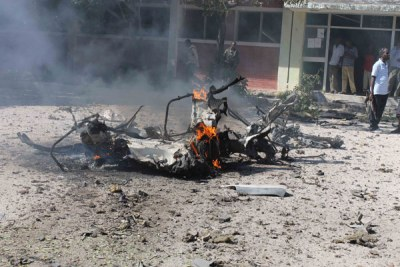 The wreckage of the car bomb after it exploded outside a Somali government building in Mogadishu (file photo).