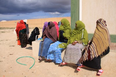 A colourful group of Somali women in the Benghazi detention centre, where they are being held after making the long, dangerous overland journey to Libya.