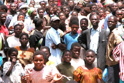 Hundreds of people queue for a monthly ration of maize-meal in Malawi.