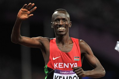 Ezekiel Kemboi celebrates winning the Men's 3000m Steeplechase at the Olympic Stadium, London.