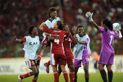 Equatorial Guinea women's soccer team celebrating.