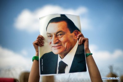 A supporter holds a poster of Egyptian former president Hosni Mubarak during a demonstration in Cairo, Egypt.
