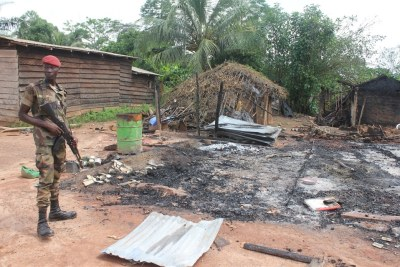 A house destroyed by violence in the west of the country (file photo).