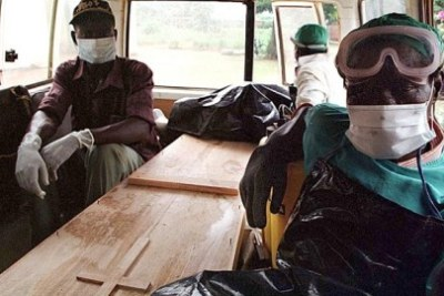 Battling the deadly virus in neighboring Guinea.
