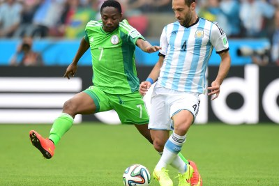 Ahmed Musa, left, seen contesting Argentina's Pablo Zabaleta for the ball, was Nigeria's hero of the match, scoring both the side's goals.