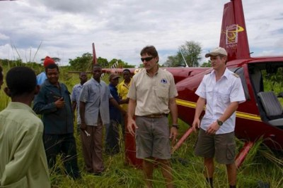 Helicopter pilot Roger Gower, right, assists with anti-poaching activities in Tanzania's Katavi National Park. On January 28, he died after he was shot by poachers while trying to track them down. (file photo)