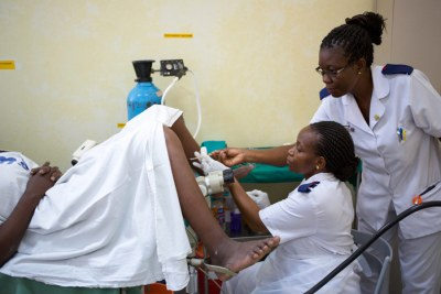 Nurse Rehema Nkomola examines a woman for cervical cancer. Global deaths from cervical cancer have increased 40% since 1990, to 266,000.(file photo).