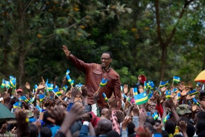 President Kagame waves to Ngoma residents during his visit to the district.