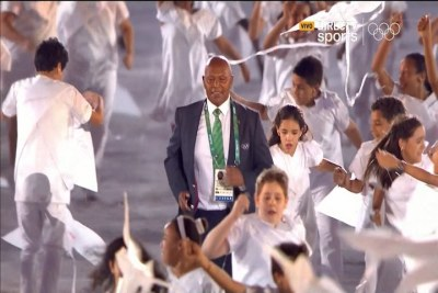 Veteran Kenyan athlete and two-time Olympic champion Kipchoge Keino, accompanied by children, runs towards the stage to receive the Olympic Laurel award at the opening ceremony of the Olympic Games at the Maracanā stadium in Rio de Janeiro, Brazil. GE has completed 80 lighting projects across Rio for the Olympic Games - including illumination of the Maracana stadium where the Opening Ceremony was held.