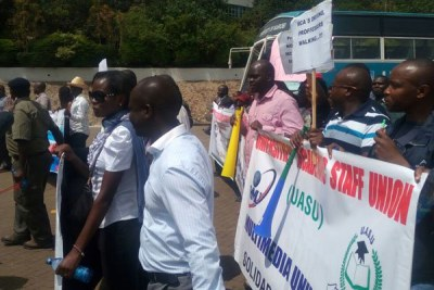 Lecturers march to Education Cabinet Secretary Fred Matiang'i's office in Nairobi.
