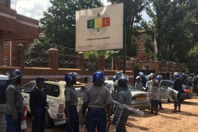 Police at the Zimbabwe Electoral Commission offices.