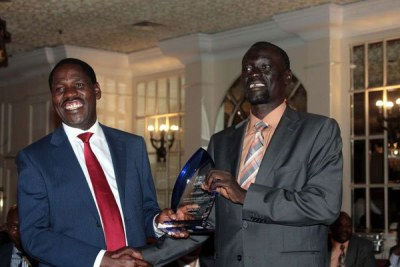 New Council of Governors chairman Josphat Nanok presents a gift to his predecessor, Peter Munya, during the governors' full council meeting at the Hilton Hotel in Nairobi on May 22, 2017.