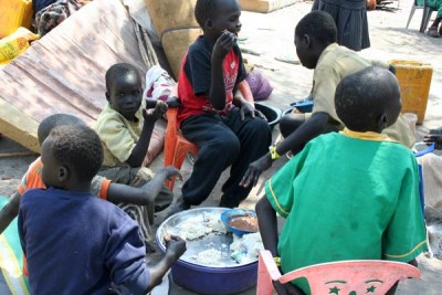 South Sudan refugee Children eating food.