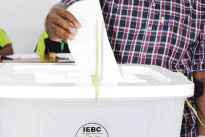 A Kenyan man casts his ballot in a past election.