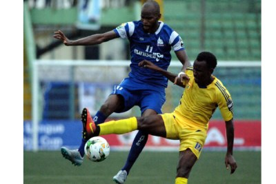 KCCA veteran Kayizzi (right) in action against Nigerian side Rivers United on Tuesday evening.