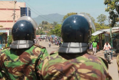 Police officers look on during anti-IEBC protests in Homa Bay on October 2, 2017.