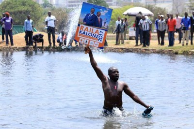 Nasa supporter protests inside a pool at Uhuru Park, Nairobi, on October 11, 2017.