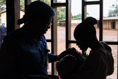 A young mother in the Central African Republic, right, was raped when she was 13. She subsequently named her baby after Gladys Ngwepekeum Nkeh, left, the UN police officer from Cameroon who cared for her after the assault.