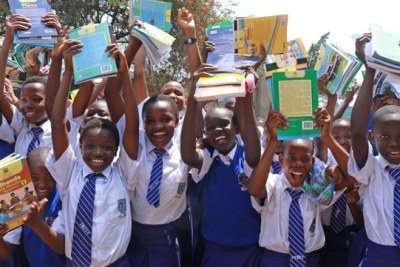 Kisumu Girls High School students celebrate after receiving textbooks from the national government (file photo).