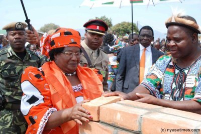Former President Joyce Banda laying a foundation stone.(file photo).