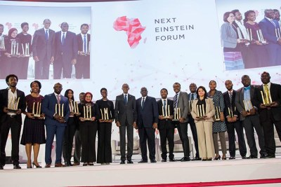 Presidents Paul Kagame of Rwanda and Macky Sall of Senegal (centre) pose for a group photo with 17 African scientists who were recognised for their outstanding contribution towards advancing science on the continent.
