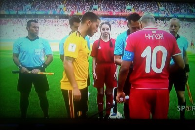 Belgium and Tunisia team captains toss the coin before their match at World Cup 2018.
