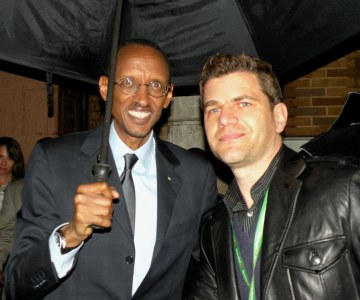 President Kagame shares umbrella with Tom Murro