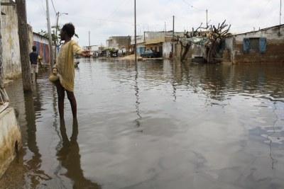A girl walks through a flooded street in Dakar, Senegal (file photo).