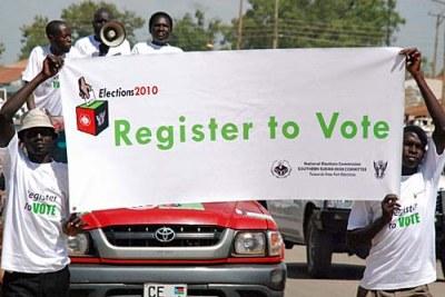 Avril 2010 - Des marcheurs exhortant les gens à se faire enregistrer sur les listes electorales