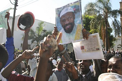 Protesters wave placards during a march in Nairobi to demand release of Jamaican preacher Abullah al-Faisal on January 15, 2010.