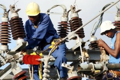 Kenya Power and Lighting Company Limited workers repair a power supply line.