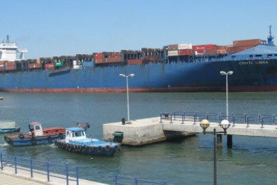 A cargo ship passes through the Suez Canal, a vital link in world trade,that contributes significantly to the Egyptian economy.