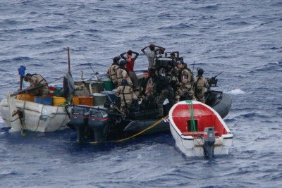Suspected Somali pirates are apprehended by a patrol of the European Union Naval Force Somalia (EUNAVFOR), one of several initiatives to combat piracy against international shipping off the coast of Somalia (file photo).