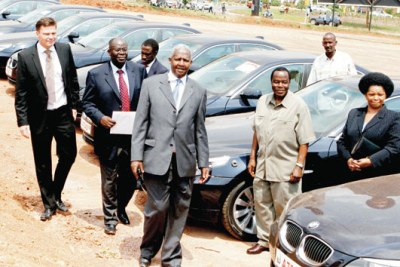 Minister Kutesa (front) and Motorcare manager Kim Vandbaek (Left) inspect some of the BMW cars used during Chogm at Shimoni grounds in 2007.