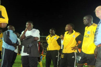 A glum Cranes coaching team and players after the match.