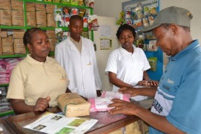 Kenyan farmer Phillip Ngolania buying drought-resistant seeds at Dryland Seed Company, Machakos.