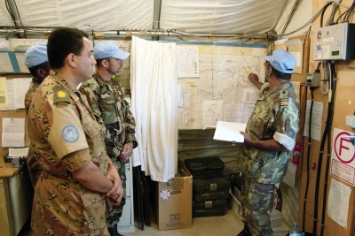 United Nations Mission for the Referendum in Western Sahara (MINURSO) troops participate in a briefing before going on patrol in Mahbas, Western Sahara.