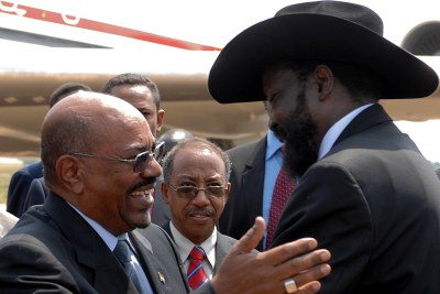 Omar Hassan Ahmad Al-Bashir, President of Sudan, and Salva Kiir Mayardit, President of the Republic of South Sudan, greet each other at the Independence Ceremony of the new nation.