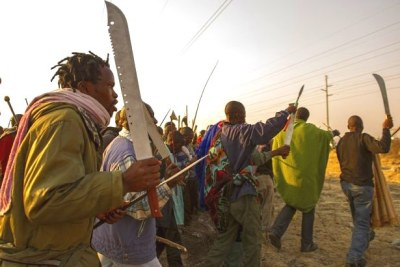 Striking workers at Lonmin's Marikana mine. The shooting erupted when police sought to disperse armed, striking workers who had gathered on a hill, in the area that had already seen several deaths in violent protests in the past week.