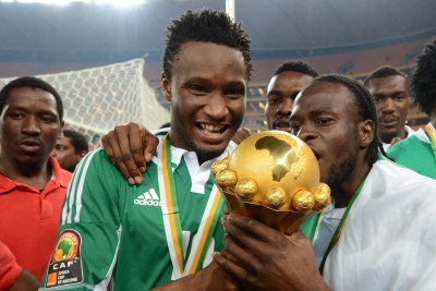 John Obi Mikel and Victor Moses of Nigeria celebrate winning the 2013 final.