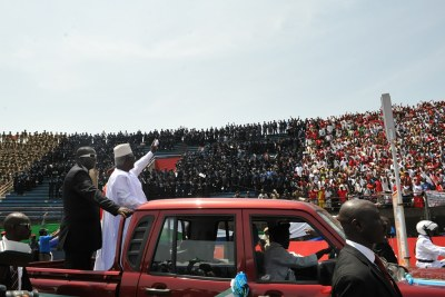 President Ernest Bai Koroma waves to thousands of supporters.