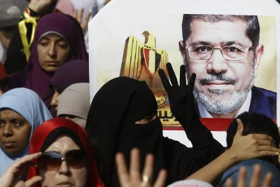 Supporters of the Muslim Brotherhood and ousted Egyptian President Mohamed Mursi take part in a protest (file photo).